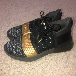 Gold and black under armor basketball shoes